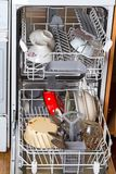 Dishwasher with dirty dishes Stock Photos