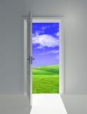 Open door on field Stock Photography