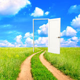 Open door in field. Conceptual image - a way to freedom Royalty Free Stock Photography