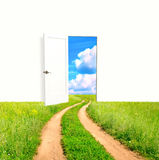 Open door in field. Conceptual image - a way to freedom Stock Photography