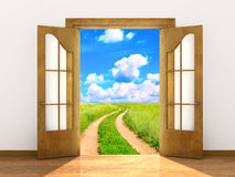Open door in field. Conceptual image - a way to freedom Royalty Free Stock Photo