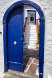 Open door of a greek house. Open door of an old typical house in Hydra Island, Greece royalty free stock photos