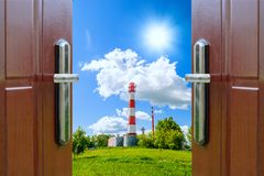 Open door with  of green meadow illuminated by bright sunshine Stock Images