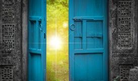 Open door and heaven light. Open blue door and sunshine. imagination concept royalty free stock photo