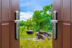 Open door kettle on a tripod Royalty Free Stock Photos
