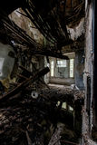 Collapsing Floor - Abandoned House. An open door leads to a room with a collapsing floor and ceiling in an abandoned house royalty free stock photos