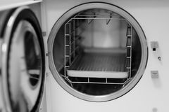 The open door of a medical autoclave. Apparatus for sterilizing surgical instruments under pressure heating Stock Image