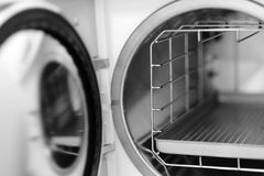 The open door of a medical autoclave. Apparatus for sterilizing surgical instruments under pressure heating Royalty Free Stock Photo