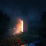 Open door at night. An open door in a pasture at night with glowing lights Stock Photos