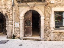 Open door in the old town Stock Image
