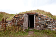 Open door root cellar Elliston Newfoundland Canada. Open door historic vintage root cellar dug underground near Elliston, Newfoundland, NL, Canada royalty free stock photo