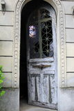 Open door of sepulchre, Pere LaChaise Cemetery, Paris, France, 2016 Royalty Free Stock Photo