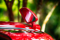 Open door and side view mirror of exotic luxury car Royalty Free Stock Image