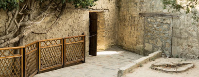 The open door in the stone fence. Royalty Free Stock Images
