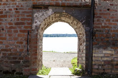 Open the door on the stone wall of the fortress castle overlooking the lake. Excellent background. Stock Image