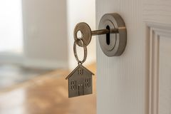Free Open Door To A New Home With Key And Home Shaped Keychain. Mortgage, Investment, Real Estate, Property And New Home Concept Royalty Free Stock Photography - 168140187
