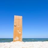 Open door to beach and blue sea Stock Image