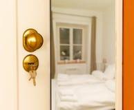 Open door to bedroom Stock Images