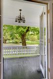 Open door to the front porch with view of the park. Royalty Free Stock Images
