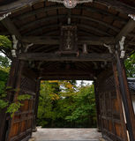 Open door to Japanese garden in early autumn Royalty Free Stock Image