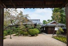 Open door to Japanese garden in early autumn Royalty Free Stock Photo