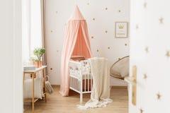 Open door to pink nursery stock images