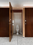 Open door to public toilet Stock Photo