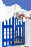 Open door in a typical Greek house of Santorini. Island Stock Photo