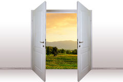 Open door. View of mountain landscape through open door Stock Photo