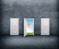 Open door with a view of the sky and hot air balloons. Concrete room Royalty Free Stock Images