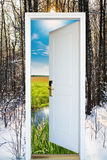 Open door and a winter forest Stock Photos