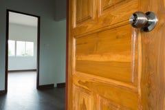 Open the door. Open wooden door empty room in building residential house stock photo
