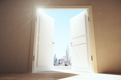 Open doors from empty room to megapolis city with skyscrapers Royalty Free Stock Photography