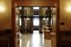 Open Doors Of Kansas State Library. A view into the open doors of the Kansas State Library inside the statehouse in Topeka Kansas Royalty Free Stock Photo