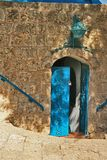 The open doors in the past. On a ladder downwards in the old city of Jafo by an old gate, in Israel Royalty Free Stock Photos