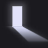 Open doorway. With light streaming in Royalty Free Stock Photo