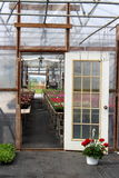 Open doorway leading into greenhouse Royalty Free Stock Photo