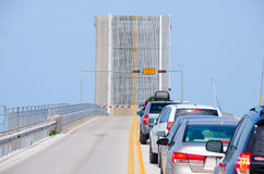 Open drawbridge with cars waiting to cross bridge Stock Photo