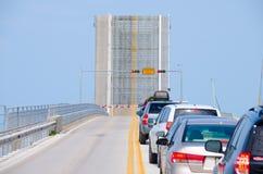 Open drawbridge with cars waiting to cross bridge Stock Photo