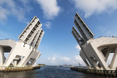 Open Drawbridge. A double leaf Drawbridge opened to let a large boat go through the road Stock Images