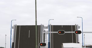 Open drawbridge in Netherlands with cars waiting in front stock footage