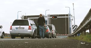 Open drawbridge in Netherlands with cars waiting in front stock video footage