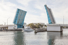 Open drawbridge in Pompano Beach, Florida. Boat coming through the open drawbridge in Pompano Beach. Florida, United States Royalty Free Stock Images