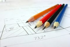 Open drawings with a pencil. Engineering and design. Construction projects. Planning royalty free stock photo