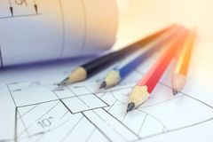 Open drawings with a pencil. Engineering and design. Construction projects. Planning Stock Photography