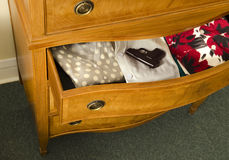Open dresser drawer with gun Royalty Free Stock Photography