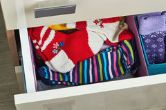 Open dresser drawer with socks. Open dresser drawer with different socks stock photography