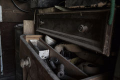 Open dusty old drawer full of tools in the workshop Stock Photos