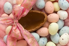 Open easter egg. Pastel easter eggs and one open chocolate large egg Stock Photos