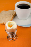 Open egg. Open hardboiled egg on a breakfast table Royalty Free Stock Photos